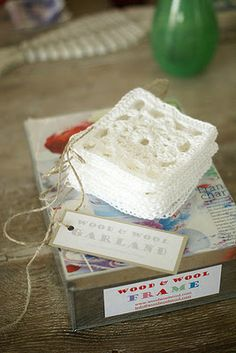 Garland of tiny Granny-inspired squares ion white - nice for Christmas or winter ...