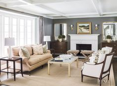 Traditional Gray Living Room with Marble and Wood Fireplace