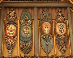 Sam Howzit  Tiki Shields  These shields are above the exit to Walt Disney's Enchanted Tiki Room