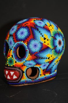 Huichol Art Pieces [skulls & masks]