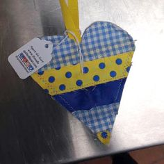 I found this heart in Bowling Green, Kentucky. I was working an early morning breakfast shift at the Farifield Inn and Suites. I was getting ready for the guests and looked up to see this heart hanging off of a bar stool. It is a smile maker!!  #IFAQH #ifoundaquiltedheart