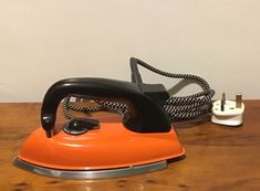 A bright orange light weight iron, made in Britain by Morphy Richards in the & ( Model This iron is in full working order and heats up super fast. Iron weighs 8 long by 4 wide. Light Orange, Electric, Home Appliances, Iron, Bright, The Originals, Etsy, Vintage, Products