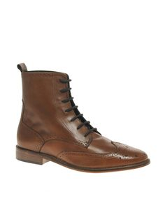Wing-tip brogue boots