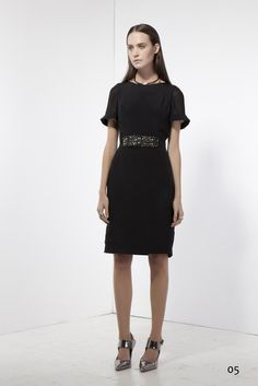 Black Cady dress with gemstone detail on waist
