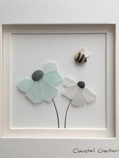 Sea glass and pebble art flowers with bubble bee