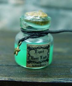 Make own label.use highlighter in water for glow.what color is moonlight? Find moon charm for bottle. Magic Bottles, Bottles And Jars, Perfume Bottles, Halloween Potion Bottles, Halloween Apothecary, Halloween Jars, Holidays Halloween, Halloween Crafts, Halloween Decorations