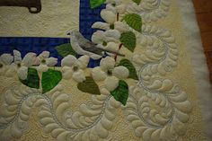 Simply beautiful appliqued and quilted border.