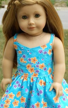 Blue Floral WrapTop Style Sundress For by AngelKissesBoutique. Made using the Wrap Top Dress pattern. Find it here http://www.pixiefaire.com/products/wrap-top-dress-18-doll-clothes. #pixiefaire #wraptopdress