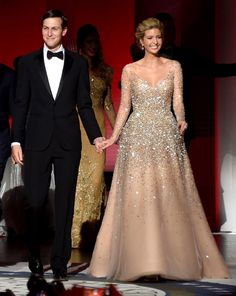 ivanka trump dress inaugural ball gown was  a long-sleeve dress that featured sparkling gold fleck detail, complemented by dangling diamond earrings.