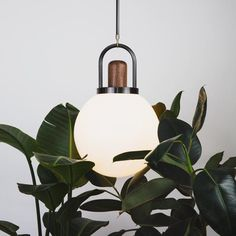 This pendant is designed with a focus on simplicity, emphasizing the high quality of the material and the balance of the form. The carefully shaped arc of the b