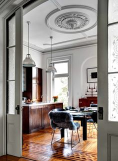 Kitchen - beautiful floor, plaster medallion and pocket doors | Photo: Bruce Buck for The New York Times