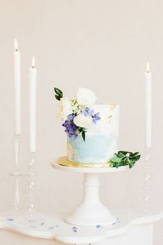 Delicate Watercolor Wedding Cake with Edible Gold Leaf | Heather Mills Photography | http://heyweddinglady.com/elegant-watercolor-wedding-shoot-bold-cobalt-blue/