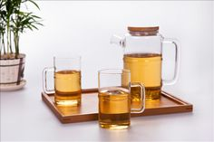 Glass teapot with Bamboo lid and matching cups,all shapes like bamboo...