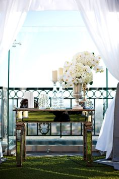 this idea but with our birdcages and jars and flowers etc...under the arbor