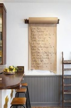Hang a roll of butcher paper on the wall and use it to scrawl to-dos, grocery lists, etc.