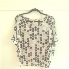 MONA B SHEER POLKA DOT BLOUSE Great shirt for a night on the town! Sheer blouse top with black polka dots. Scoop neck. Short sleeves with slits and white and gold accent buttons. Hand wash. Mona B Tops Blouses