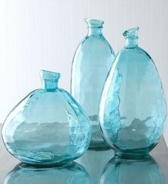 Turquoise, recycled glass vases pick up the color from the side chair. Shades Of Turquoise, Bleu Turquoise, Aqua Blue, Shades Of Blue, Periwinkle Blue, Cobalt Blue, Love Blue, Diy Shows, Aqua Glass