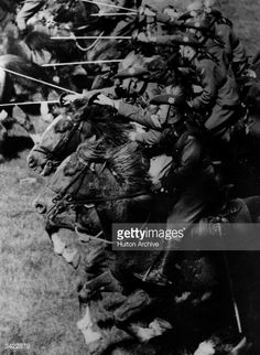 Members of the Australian 2nd Cavalry Division undergoing training near Melbourne. Here they charge with swords advanced.