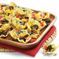 Nachos with only 125 calories! Make this healthier option for Super Bowl Sunday. Use baked tortilla chips, reduced-fat cheese and tomatoes.