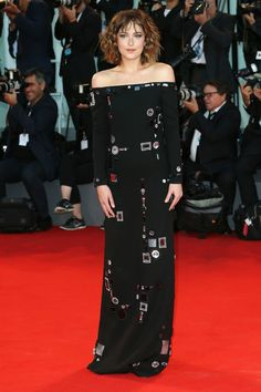 Dakota Johnson at the premiere of A Bigger Splash. See all the looks from the Venice Film Festival.