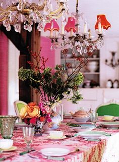 `Gorgeous colors...beautiful pinks and pops of green, yellow, and orange. Very pretty, but fun, dining room!