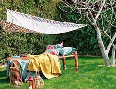 Una sombra a toda vela  Elige una tela bonita y hazte un práctico toldo para disfrutar al aire libre de tus siestas veraniegas...