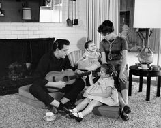 From 1950-1954, Johnny Cash served in the U.S Air Force. He then settled in Memphis, Tennessee and married Vivian Loberto. The couple is seen here at home with two of their four daughters.