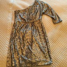 Metallic Trina Turk dress Metallic grey/silver Trina Turk Dress. One sleeve. Hits above the knee. Excellent condition. Never worn. Trina Turk Dresses Mini