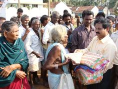Believe it or not, India can get very chilly at night, and many people lost everything they had in the great floods of 2013. Here, Rev. Joseph Yelchuri hands out clothing to those in need.