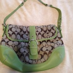"Cute coach purse Brown with green trim and silver hardware. Good used condition. Has a little wear on strap. No other visible flaws. 13W X 9L.  10"" (at longest) adjustable strap. Was told it wasn't authentic by another posher. I don't know, it was a gift. Coach Bags Shoulder Bags"