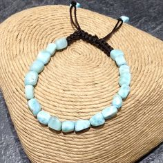 Receive a fun and fashionable Larimar bracelet as a free gift with any $500 purchase of Marahlago Larimar jewelry! Adjustable length macrame cord with polished Larimar pebbles. Hurry while supplies last!
