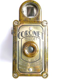 GREEN Coronet Midget Bakelite Camera .....got to handle one of these the other day. They are tiny, about the size of my thumb.