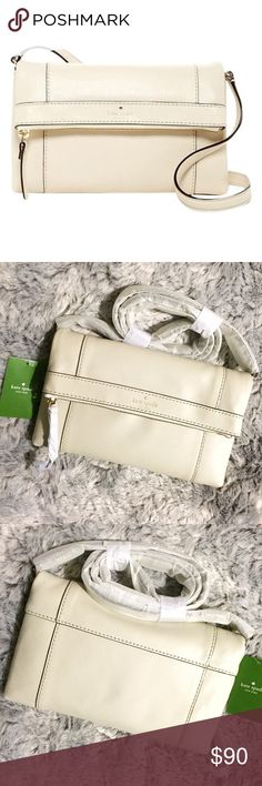 """Kate Spade Julian Porcelain Leather Crossbody Bag Brand new with tags, still has packaging around strap and zipper pull! This Kate Spade Julian Porcelain Leather Crossbody Bag is made of the softest leather! Comes in the color Porcelain, which is an off white color. Has a single shoulder strap, foldover flap with magnetic closure. There is also an exterior zippered compartment. Beautiful lining inside with a small zippered pocket. Measures 10"""" W x 6"""" H x 0.75"""" D. Approximately 22"""" strap…"""