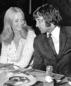 """George Best and Barbara Werle. Manchester United star Best chats in a Cardiff nightclub with Werle, Hollywood star, of the film """"Krakatoa - East of Java""""."""