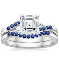 Wispy vines of precious metal entwine toward lustrous marquise-shaped sapphire buds in this nature-inspired trellis ring. The matched band sits flush and features a trio of marquise-shaped sapphires in a delicate floral pattern.