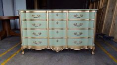This looks like the dresser in my mom's basement...maybe we could paint it and use this for the baby??