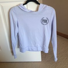 PINK long sleeve top with hood Blue long sleeve top with hood from PINK. Never worn. PINK Victoria's Secret Tops Sweatshirts & Hoodies