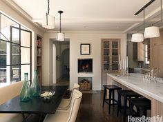 Elevated Fireplace in Kitchen - Wall Paint Color - Pratt & Lambert Chalk Grey - House Beautiful Kitchen