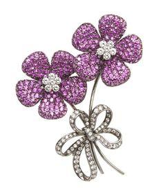 An 18 Karat Oxidized Gold, Pink Sapphire and Diamond FlowerBrooch