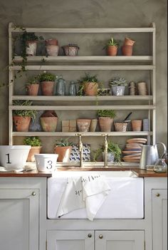 Gold taps, terracotta pots and butler sink