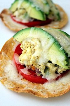 Breakfast egg & avocado tostada.  This was AH MAZING!!!  Sprayed corn tortillas with oil, baked at 325 for about 15 minutes.  Pile on scrambled egg, avocado, tomato, and queso fresco.  SO GOOD!