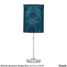 Abstract geometric design: blue webs on blue table lamp.