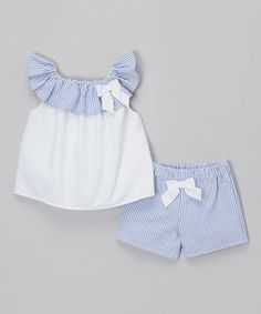 A seersucker ruffle ups the girly appeal of this cotton top's roomy silhouette, while the elastic-waist shorts create a custom fit.