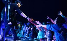 Troops and military families stationed at Aviano Air Base in Italy recently gathered to spend some quality time together at a USO concert featuring one of today's hottest country music artists Brantley Gilbert.