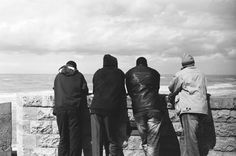 African migrant workers staring into the sea, Yaffo, Tel Aviv.