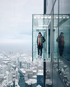 From the 103rd floor of the Willis Tower, @petewilliams takes in Chicago at the city's highest vantage point. The Ledge, which opened in 2009, was created to enhance a classic SOM building with an innovative addition in the spirit of the original design. Minimal five-sided glass balconies allow for views in all directions and provide the sensation of being suspended in the air. Approximately 4 feet deep, 10 feet high, and 10 feet wide, the ledges are made of laminated glass panels hung from…