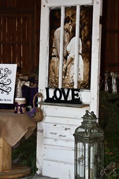 old door with enlarged engagement picture used at wedding