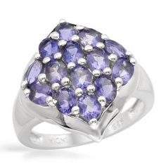 Ring With Genuine Iolites - Size 6 Wonderful ring with genuine iolites well made of 925 sterling silver. Total item weight 6.1g. Gemstone info: 14 iolites, 2.80ctw., oval shape and blue violet color.