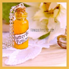 Butterbeer Necklace Harry Potter Inspired  glass by tranquilityy