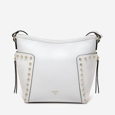 """Glazed vegan leather crossbody with top zipper closure. Gold plated metal studs and zipper side detail.Adjustable long shoulder strap.Inner smartphone and accessories pockets, and inner zip compartment. Dimensions: 9.5"""" (L) x 9.5"""" (H) x 4.5"""" (W) Also available in Turquoise, Raspberry"""